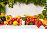 Fruit and vegetable borders on white wooden old table