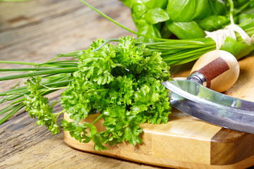 fresh and chopped herbs on cutting board