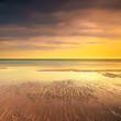 Ocean sandy beach line and warm sunset