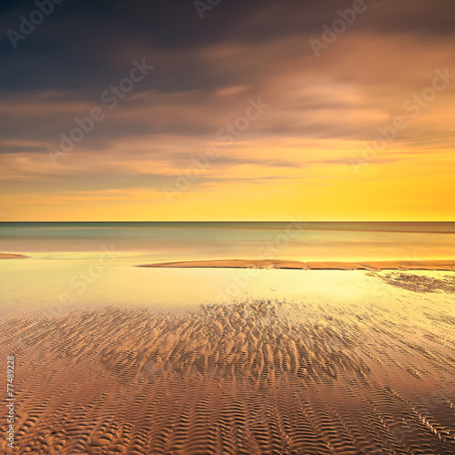 canvas print picture Ocean sandy beach line and warm sunset