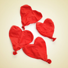 deflated heart-shaped balloons, with a retro effect
