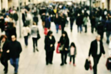 defocused blur background of people walking