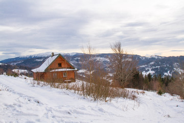 Mountain cottage  in winter.  Silesian Beskids Mountains, Poland