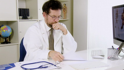 Young doctor in office worried