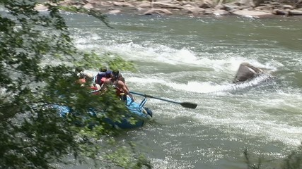 People rafting on rapid waters. Longest bicycle competition over United States of America - RAAM in 2009.