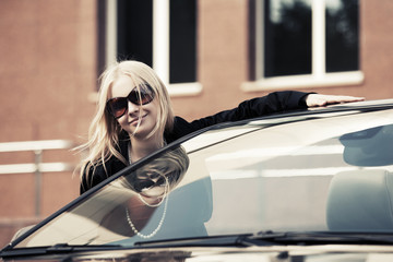 Happy young fashion woman at the convertible car