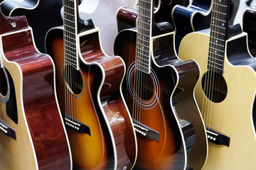 Guitars in the store background