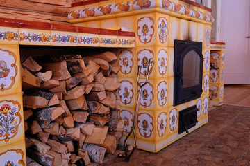Fireplace in the Russian style with firewood
