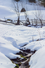 River in the village in winter time
