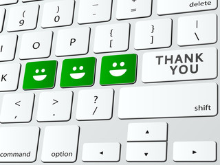 Thank you written over computer keyboard with happy faces