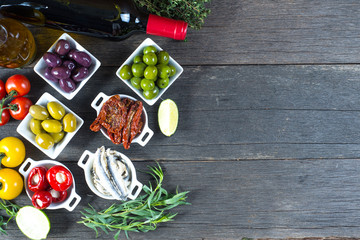 selection of spanish tapas with red wine from above