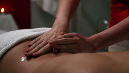 Woman getting a massage in a beauty salon