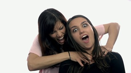 One women trying to strangle another on white background