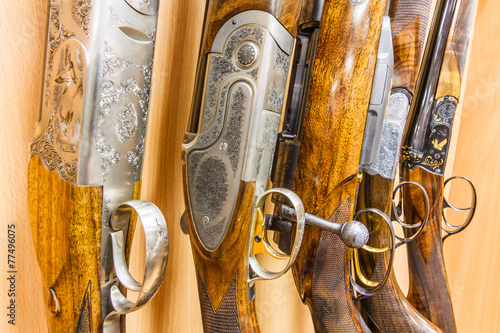 Fotobehang Jacht close up of a row of guns displayed in gun shop