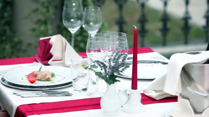 young couple in love having dinner inside beautiful restaurant with fancy place settings