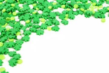 St Patricks Dayborder of green shamrock candy sprinkles