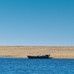 Solo Rowboat Moored on Sandy Beach