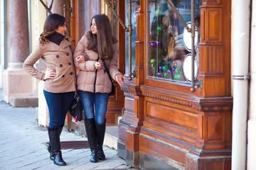 Two young woman enjoying walking and shopping