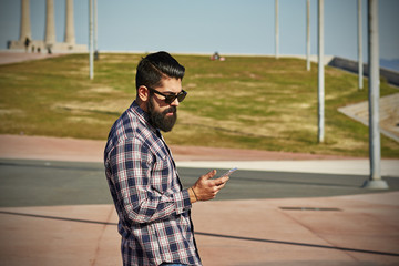 Young hipster man on the phone