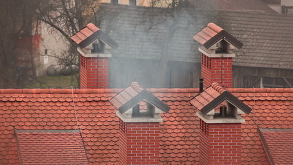 Still shot of smoking chimney