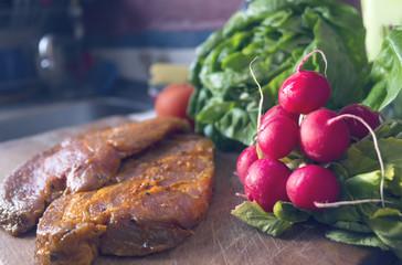 Raw seasoned pork meat on cutting board in the kitchen