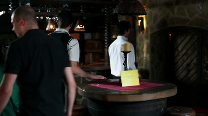 HD1080p: Waiter expecting guests in wine cellar