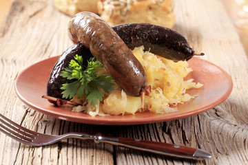 Roasted sausages with sauerkraut and potatoes