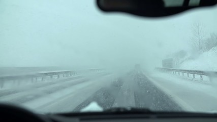 Driving through the snow with activated wipers