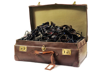 An old suitcase full of sunglasses
