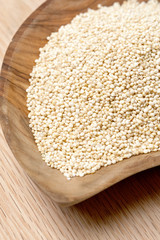 Quinoa seeds on a wooden bowl