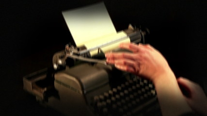 Dramatica camera movement and added video effect while showing typing on a typewriter