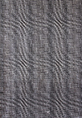 Hand-woven geometrical pattern in black and white