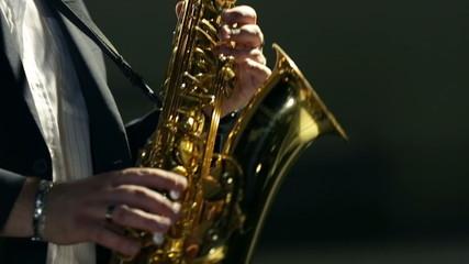 Close shot of saxophone player