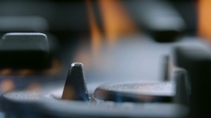 Extreme close up on fire from gas cooker cooktop