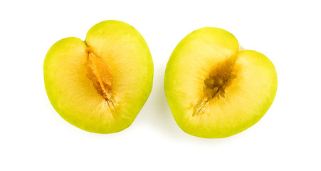 Inside of juicy green plum with seed and core