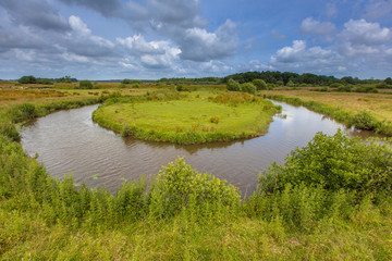 Winding meandering lowland river