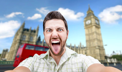 Happy young man taking a selfie photo in London, England