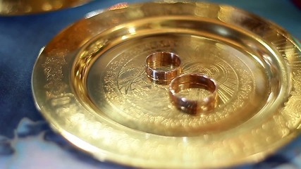 Wedding rings on Church saucer