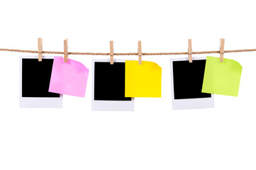 Blank photo prints and sticky notes on a rope