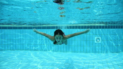 HD1080p: An under water shot of a teenage girl swimming