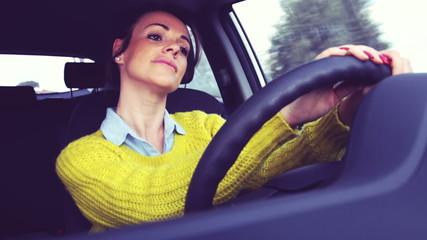 Happy cute woman driving dancing