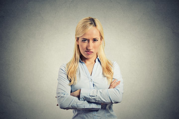 portrait angry blonde woman on grey wall background