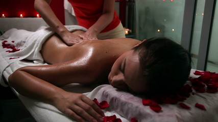 Young woman getting a massage in beauty spa