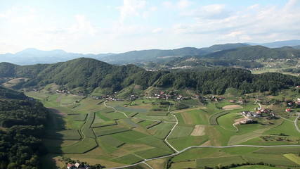 Panorama slide shot from helicopter representing  valley with small towns with lots of houses and other infrastructures