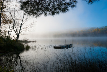 Fog rolls around a lake all morning.