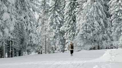 senior woman walking in winter idyll