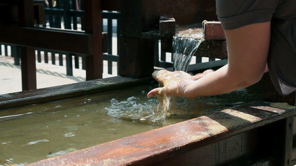 Water with gold pouring into pool