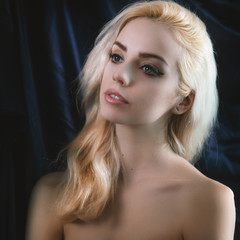 Portrait of young blond woman. Toned image. Soft focus on eyes.