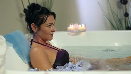 Pretty woman relaxing in hot jacuzzi