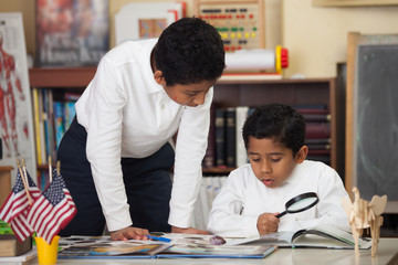 Hispanic Boys in Home-school Studying Rocks